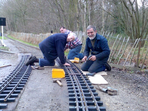 "A lot depends on the size of your plastic sleepers. At Abbeydale we use 40mm wide x 30mm deep plastic sleeper strip from Cromar White and cut to length. We used to have welded steel but now use 27mm flat bottom rails screwed down. With having 7¼""/5"" dual gauge track we decided on a compromised sleeper spacing that looked about right for all scales that run on it, from large 7¼"" narrow gauge to scale 5"" so we place our sleepers at 140mm centres. The photo shows some of our track being laid when we converted from welded steel bar some ten years ago. N.B. there are some extra rails (i.e. checkrails) going in this section because this is a level crossing - it is just 7¼""/5"". I hope that helps."