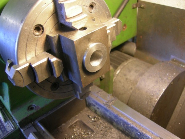 Well as nobody seems to want to jump in, it was bored out to clean the hole and another piece of cast-iron turned to fit and then bored to the correct size. A simple enough lathe job even for a beginner. If the wear had been noticed a little earlier then an oilite bush might have been used. That took care of the axle-box, but what about the axle?